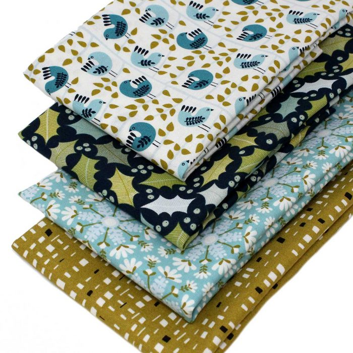 Fat quarter fabrics in green and pale blue with a retro Christmas theme.