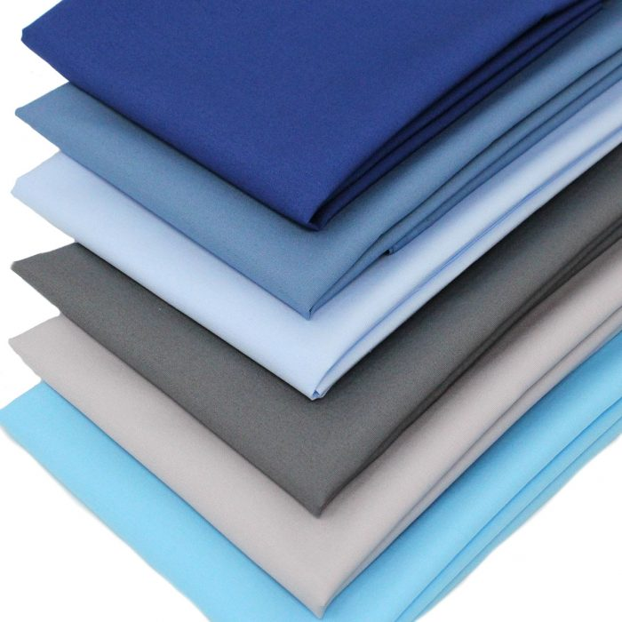 Fabric solids in shades of blue and grey.