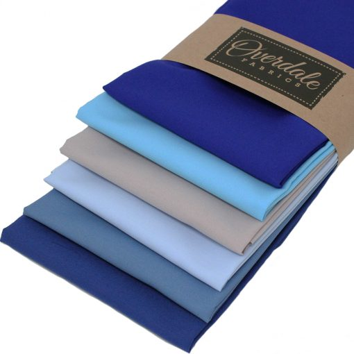 Fat quarter fabrics in shades of blues and grey.
