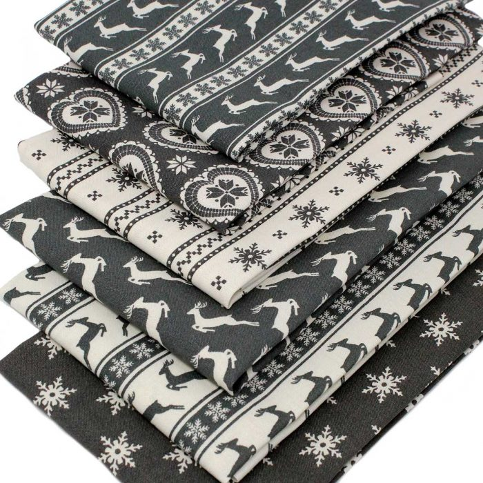 Christmas fat quarter fabrics in grey with a Scandi look.
