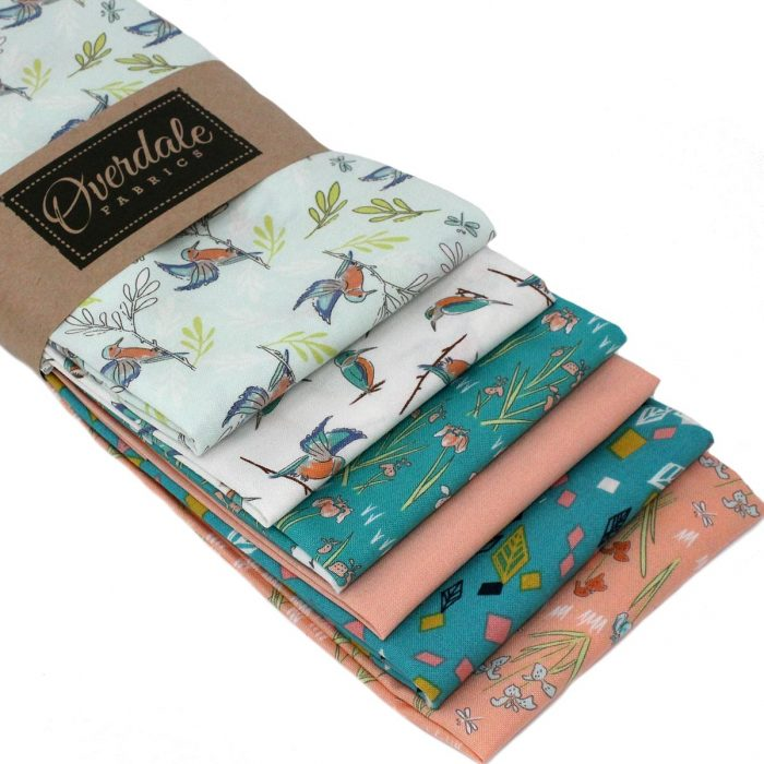 Fat quarter pack of printed designs in teal and coral.