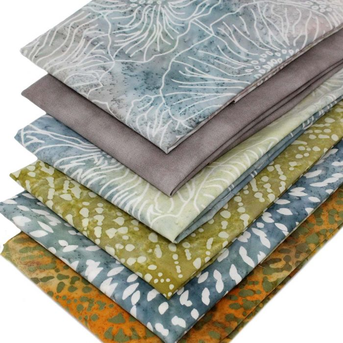 Batik fat quarters in natural shades of beige, ochre and slate blue.