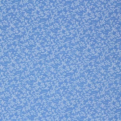 Blue fabric with a small scale daisy print in white.