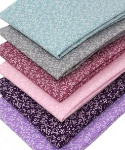 Fat quarter pack of small scale floral fabrics in pinks and purples.
