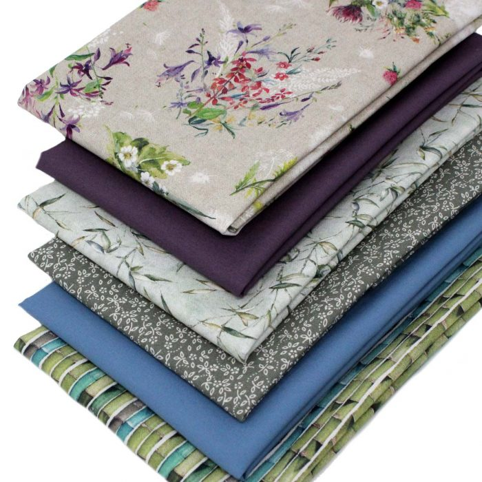 Fabrics in green, plumb and blue with a garden theme.