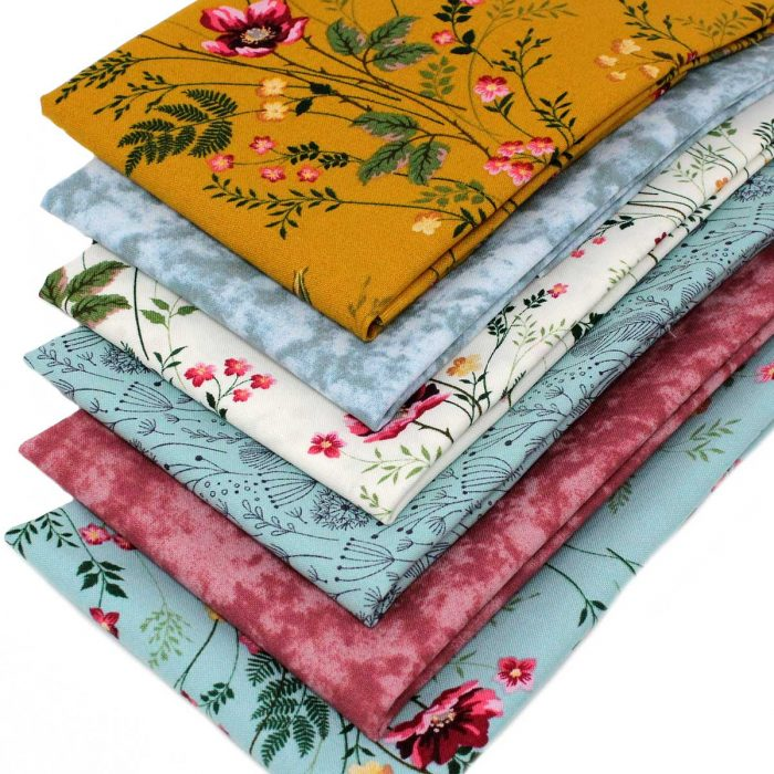 Wild rose fat quarters in ochre, pink and blue.