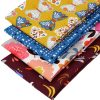 Four fat quarters featuring flowers and butterflies.