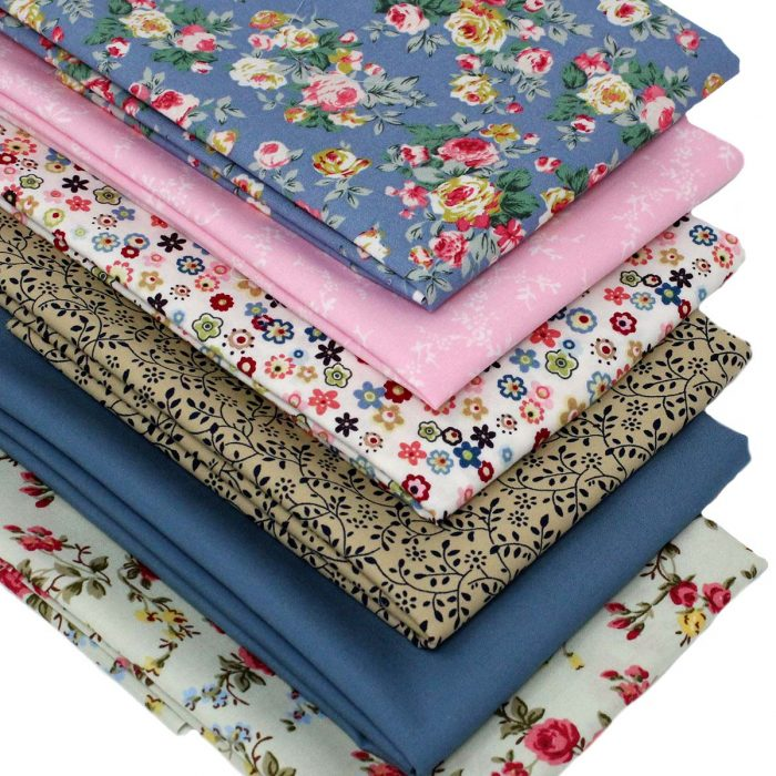 A set of floral fabrics in blue, green and pink.