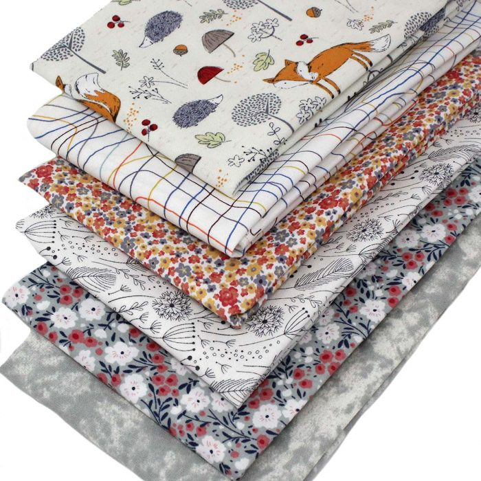 Fabrics with a fox theme in grey and orange.
