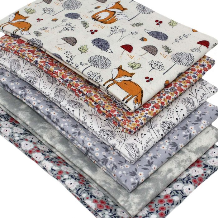 Woodland fox fat quarter pack in grey and orange.