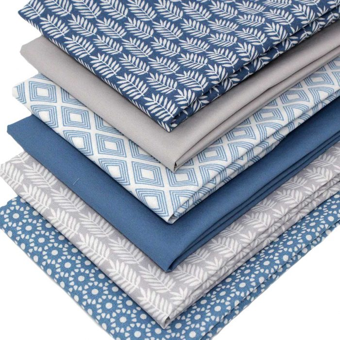 Blue and grey fat quarters with geometric Moroccan inspired designs.