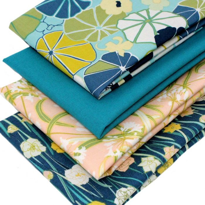 Floral fat quarters in teal, green and blue.