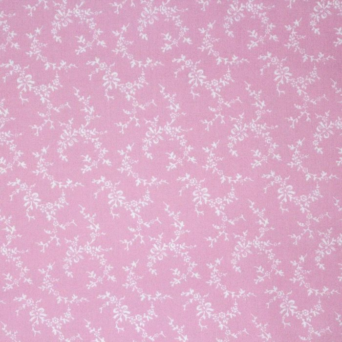 pale pink fabric with a bow pattern.
