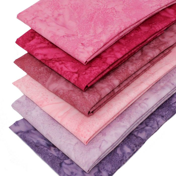 Batik fabrics in pink, lilac and purple.