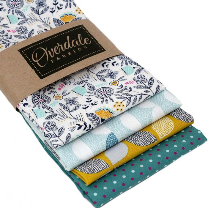 Retro fat quarter pack in mustard yellow, grey and pale blue.