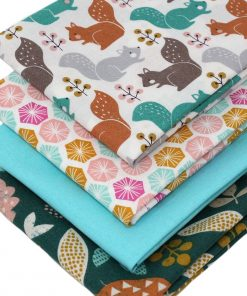 Fat quarter pack of fabrics featuring squirrels, leaves and hexagons.