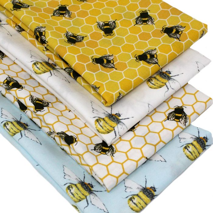Fat quarter fabrics featuring bees and honeycomb.