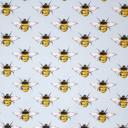 Bees on a light blue fabric.