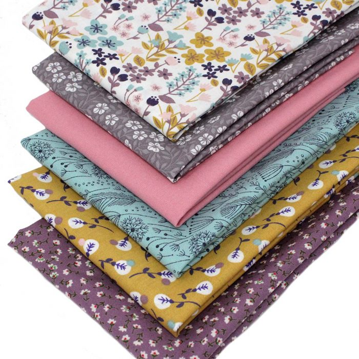 Floral themed fat quarter pack in mustard yellow and mauve.