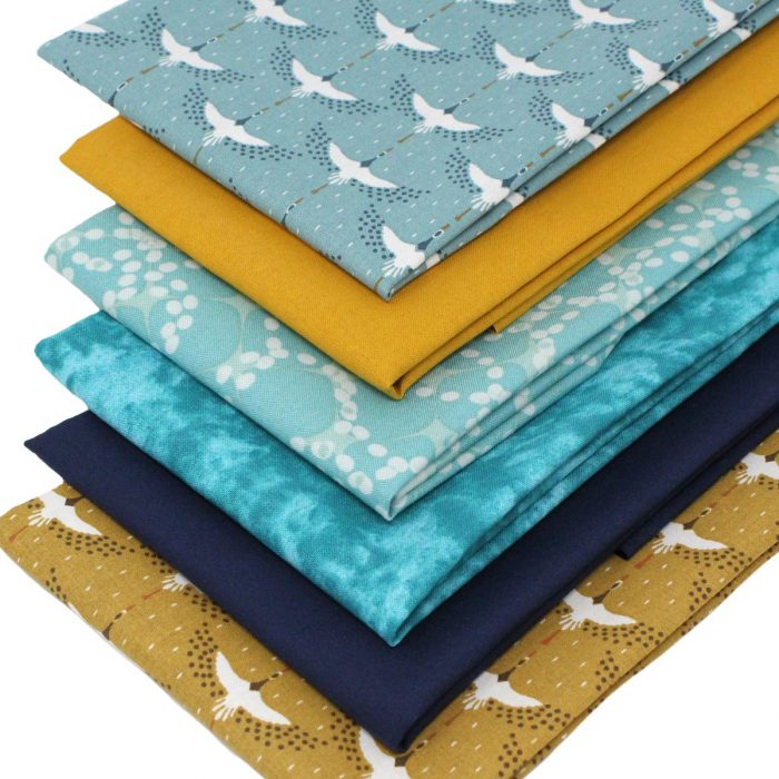 Blue and mustard yellow fabrics featuring cranes.