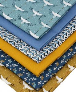 Fabrics in mustard and blue featuring cranes.