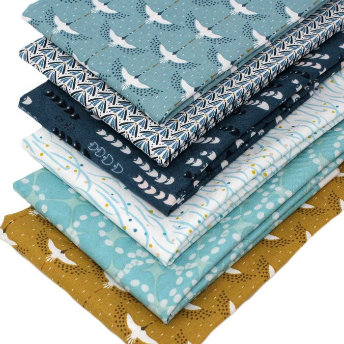 Mustard and blue fat quarter pack, featuring cranes.