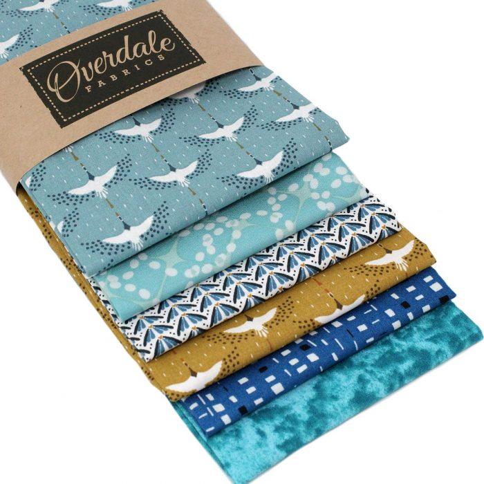 Blue and ochre fat quarter fabrics.