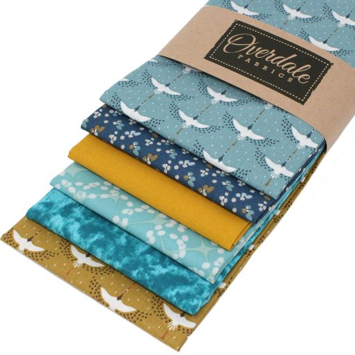 Fat quarter pack in blue and ochre featuring cranes.