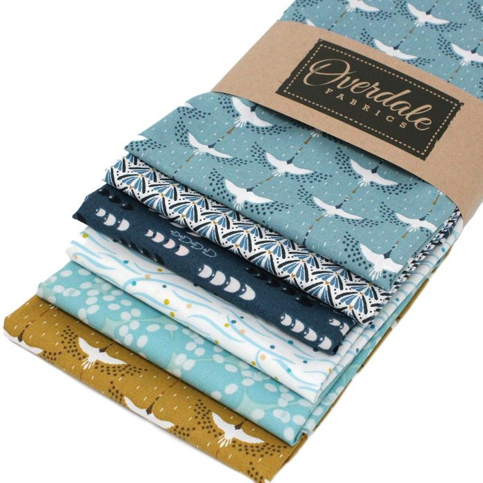 Fat quarter pack in blue and mustard featuring birds and abstract natural designs.