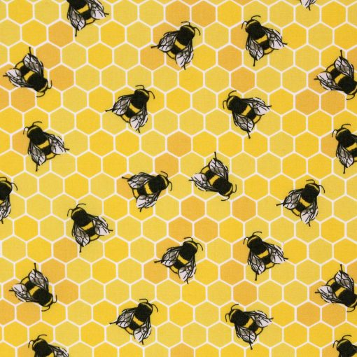 Yellow bee and honeycomb fabric.