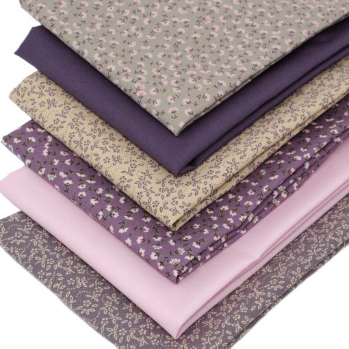 Mauve and tan floral fat quarter fabrics.