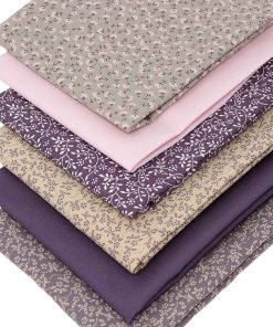 Fat quarter fabrics in shades of mauve and taupe.