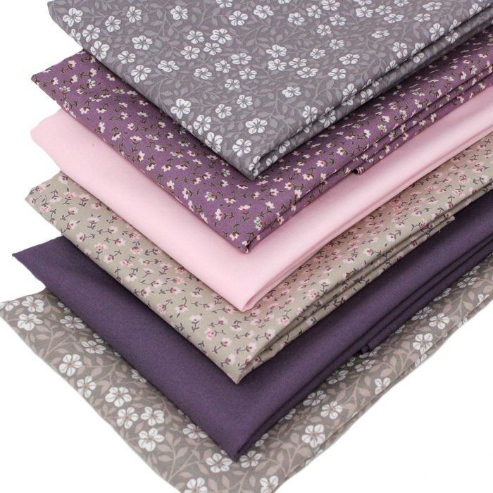 Small scale flower fabrics in shades of mauve and taupe.