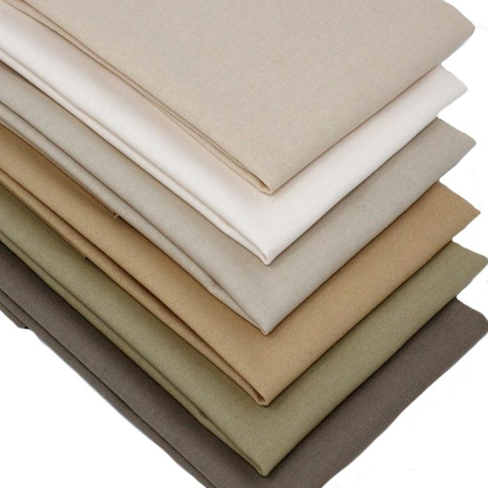 A set of fat quarter fabrics in natural shades.