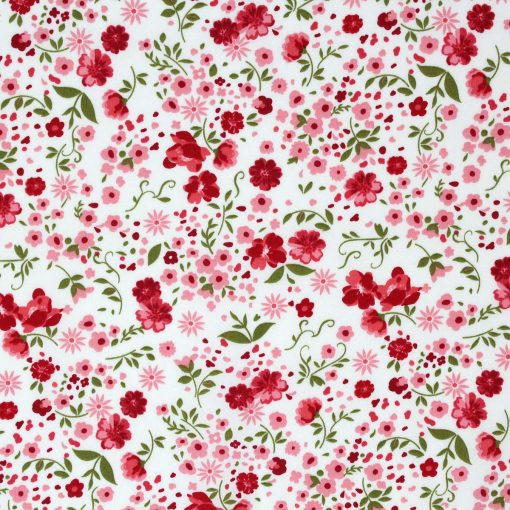 Pink and red floral fabric with a green leaf.