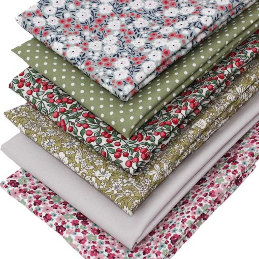 Floral fabrics in pink and green with a flower theme.