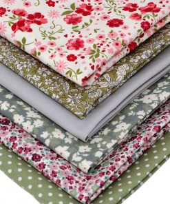 Floral fat quarter fabrics in red and green.