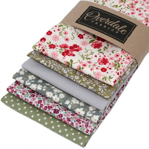 Green, pink and grey fat quarter fabrics with a floral theme.