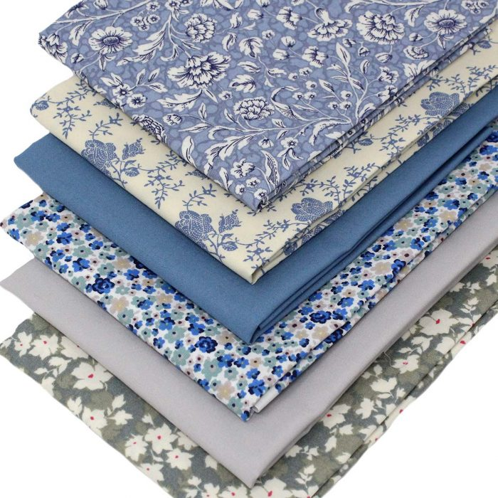 Blue and grey fat quarter fabrics featuring flowers
