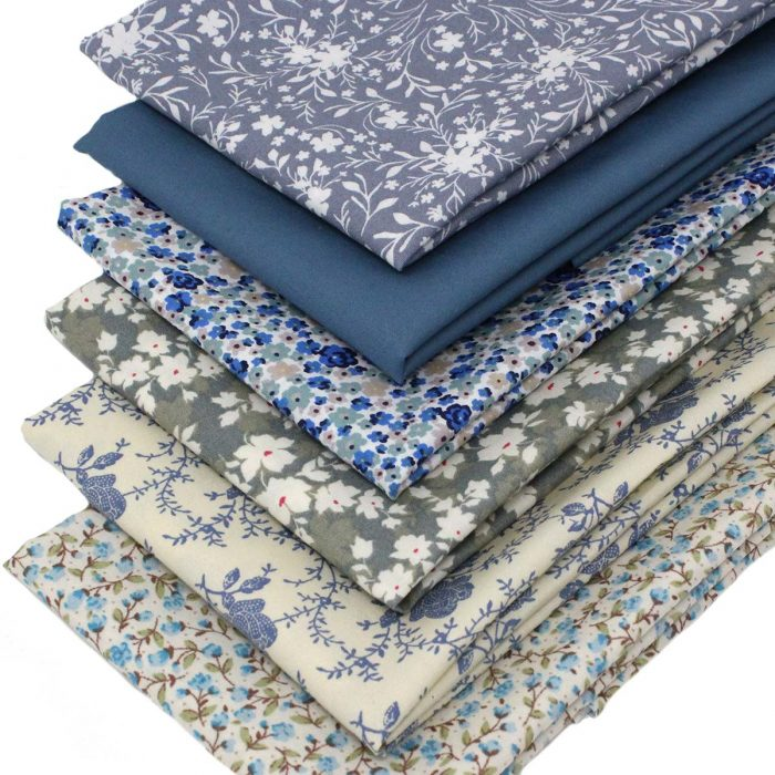 Floral fabrics in shades of blue and grey.