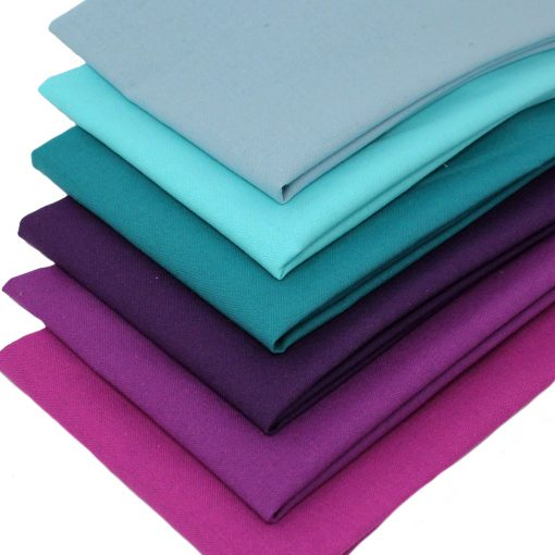 fat quarters in range of colours from teal to purple