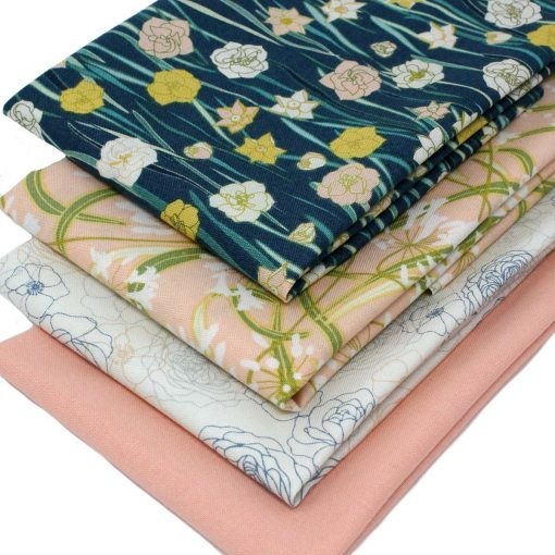 Floral fabrics in green and peach.