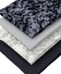 Marble and plain solid fabrics in shades of grey and black.
