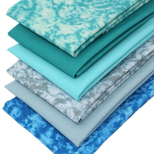 Marble and plain solid fabrics in shades of green and blue.
