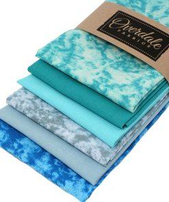 Green and blue fat quarter fabrics.