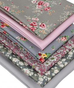 Floral fabrics featuring roses in shades of pink and grey.