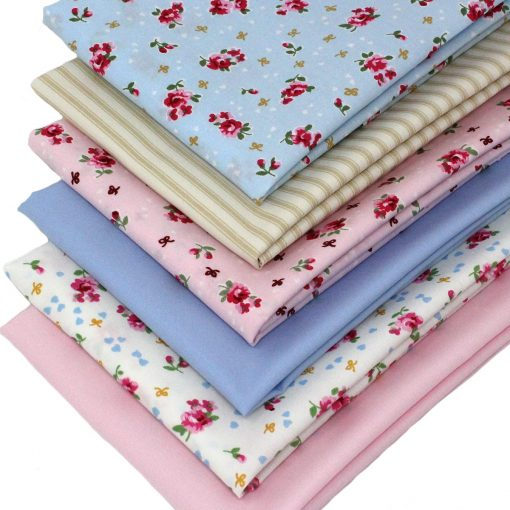 Vintage rose fat quarters with plain solids in pink, beige and blue.