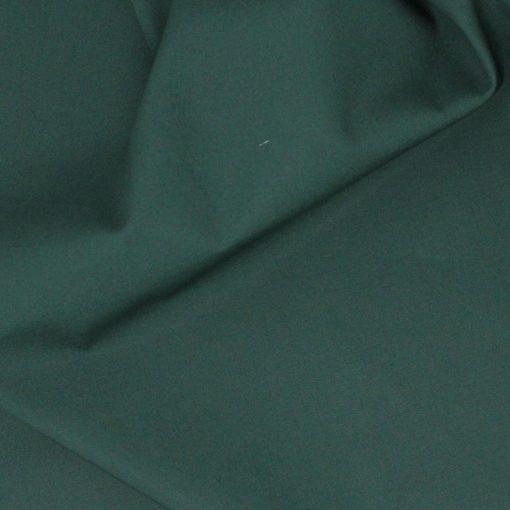Dark green plain solid fabric.