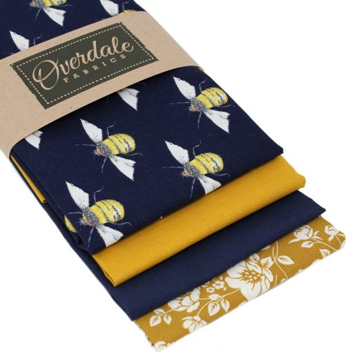 Fat quarter pack in navy blue and yellow featuring bees.