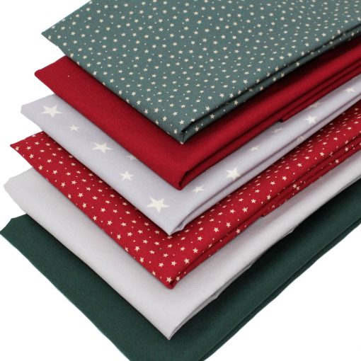 Star fabrics and plain solids in red, green and grey.